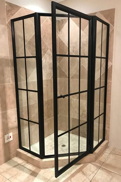 Bl;ack-Framed Shower made with Glass