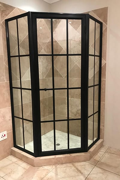 Bl;ack-Framed Glass Shower Doors